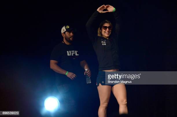 Bethe Correia of Brazil walks to the stage during the UFC Fight Night weighin at the Marina Bay Sands on June 16 2017 in Singapore