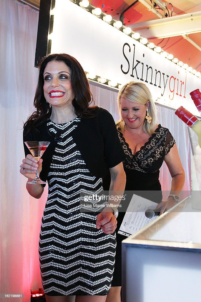 Bethenny Frankel and Angela Bishop leave the stage during the Skinnygirl Cocktail Pre-Party at Opera Point Marquee on February 20, 2013 in Sydney, Australia.