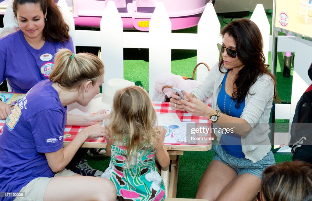 <a gi-track='captionPersonalityLinkClicked' href=/galleries/search?phrase=Bethenny+Frankel&family=editorial&specificpeople=873539 ng-click='$event.stopPropagation()'>Bethenny Frankel</a> (R) and daughter Bryn Hoppy attend the Doc Mobile Tour at the Disney Store on August 21, 2013 in New York City.