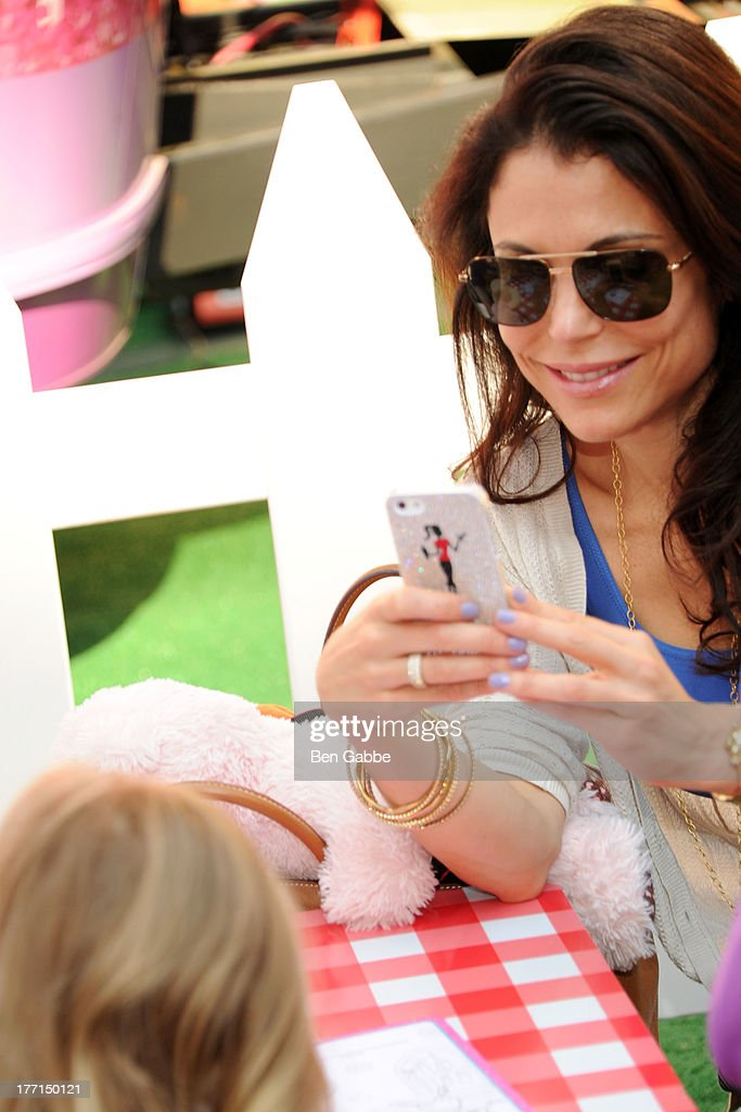 <a gi-track='captionPersonalityLinkClicked' href=/galleries/search?phrase=Bethenny+Frankel&family=editorial&specificpeople=873539 ng-click='$event.stopPropagation()'>Bethenny Frankel</a> (R) and daughter <a gi-track='captionPersonalityLinkClicked' href=/galleries/search?phrase=Bryn+Hoppy&family=editorial&specificpeople=7418444 ng-click='$event.stopPropagation()'>Bryn Hoppy</a> attend the Doc Mobile Tour at the Disney Store on August 21, 2013 in New York City.