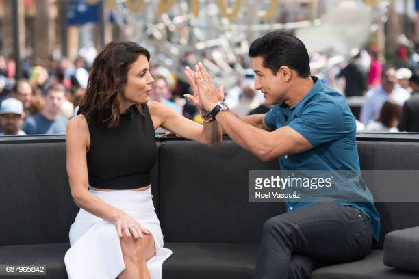 Bethenny Frankel and Mario Lopez visit 'Extra' at Universal Studios Hollywood on May 24 2017 in Universal City California