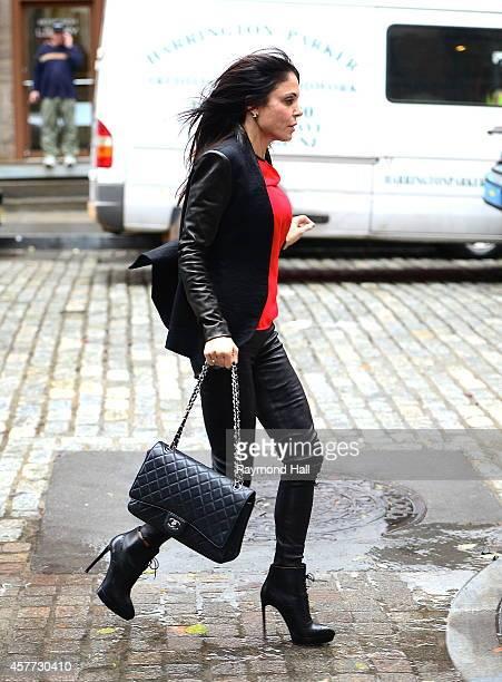 Bethenny Frankel is seen running as it rain in SoHo on October 23 2014 in New York City