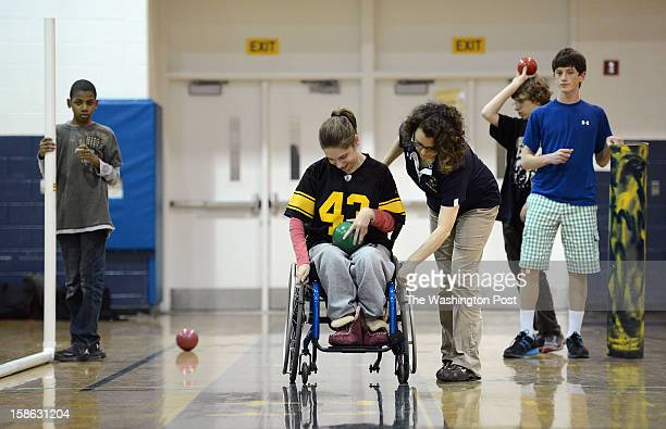 BethesdaChevy Chase High School Bocce Ball coach Leslie Gilman center right helps junior Izzy Kessler lock the breaks on her wheel chair before...