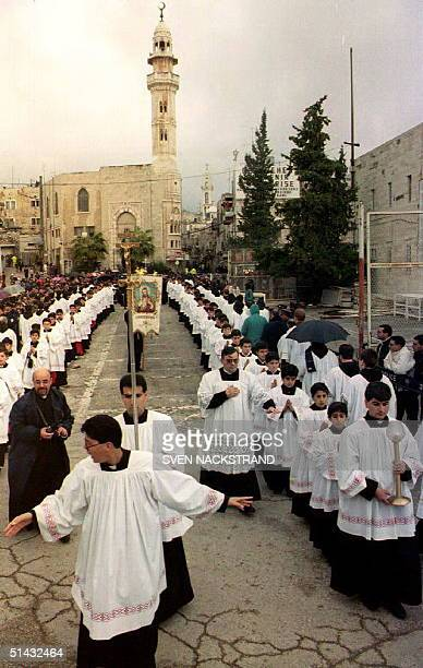 The Latin Church Christmas procession passes through Manger Square on its way to the Church of the Nativity 24 December Security is tighter than...