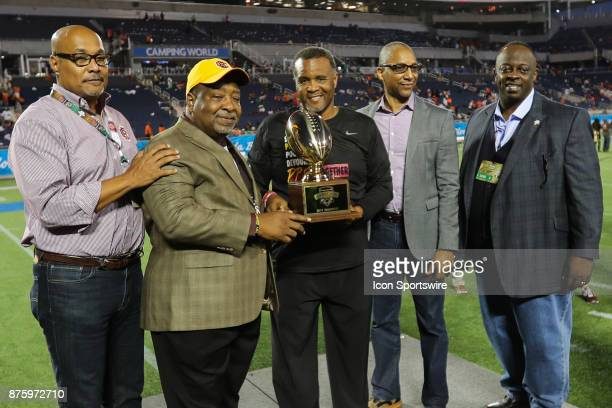 Bethune Cookman Wildcats head coach Terry Sims poses with the trophy after winning the football game between Florida AM and BethuneCookman on...