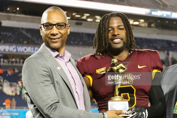 Bethune Cookman Wildcats quarterback Larry Brihm Jr is awarded the winning team MVP Trophy after the football game between Florida AM and...