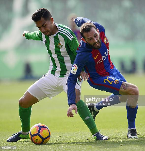 Betis' Brazilian midfielder Petros vies with Barcelona's defender Aleix Vidal during the Spanish league football match Real Betis vs FC Barcelona at...