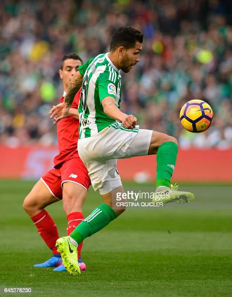 Betis' Brazilian midfielder Petros vies with Sevilla's French defender Benoit Tremoulinas during the Spanish league football match Real Betis vs...