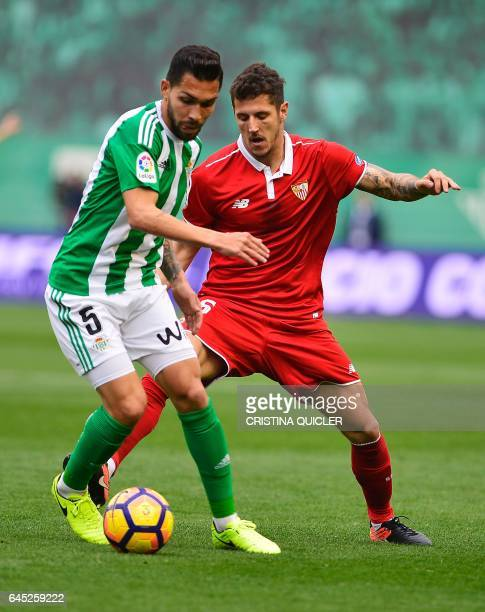 Betis' Brazilian midfielder Petros vies with Sevilla's Montenegrin forward Stevan Jovetic during the Spanish league football match Real Betis vs...