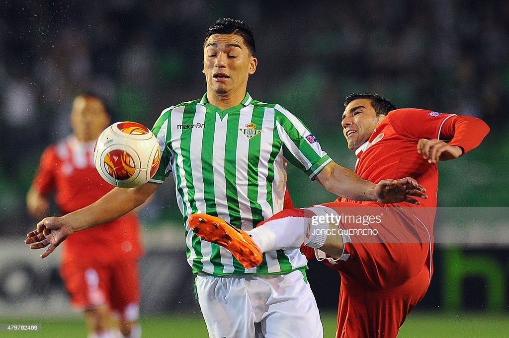 Betis' Chilean midfielder Lolo Reyes vies with Sevilla's forward Jose Antonio Reyes during the UEFA Europa League Round of 16 football match Real...