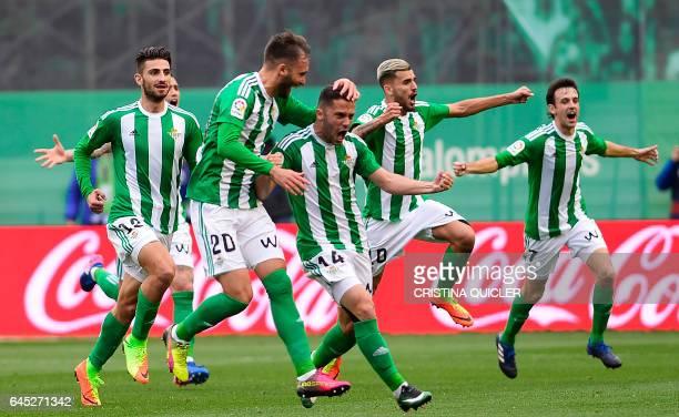 Betis' Danish defender Riza Durmisi celebrates scoring a goal during the Spanish league football match Real Betis vs Sevilla FC at the Benito...