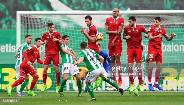 Betis' Danish defender Riza Durmisi scores a goal during the Spanish league football match Real Betis vs Sevilla FC at the Benito Villamarin stadium...