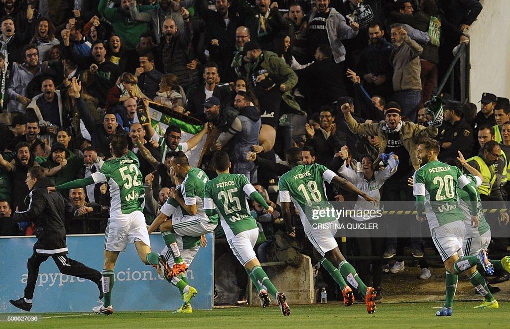 TOPSHOT Betis' defender Alvaro Cejudo celebrates after scoring during the Spanish league football match Real Betis Balompie vs Real Madrid CF at the...