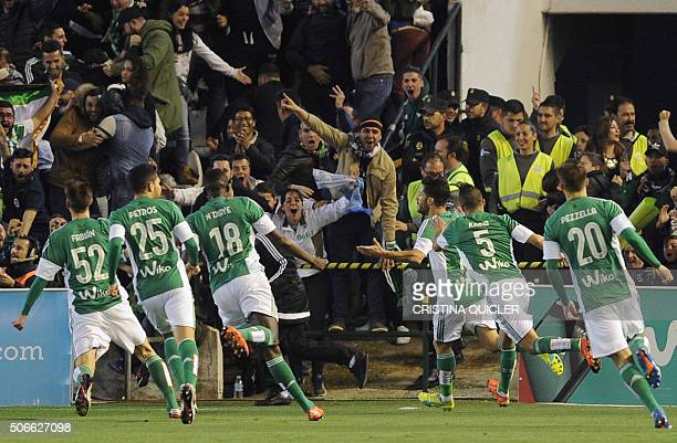 Betis' defender Alvaro Cejudo celebrates after scoring during the Spanish league football match Real Betis Balompie vs Real Madrid CF at the Benito...