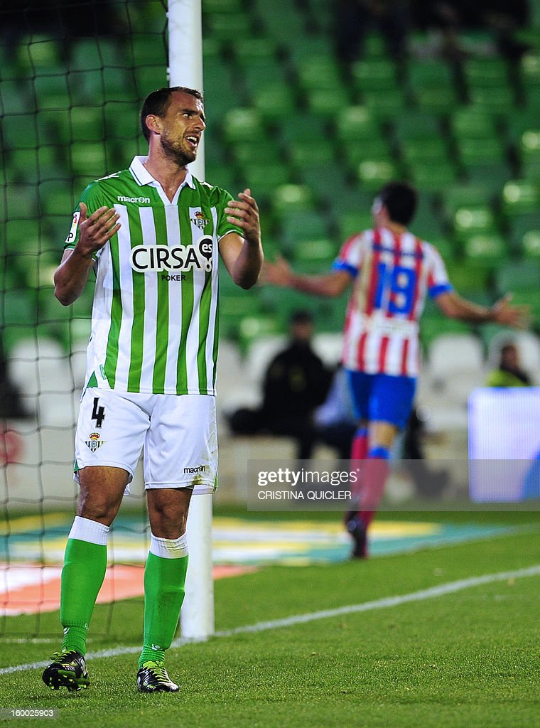 Betis' defender Antonio Amaya reacts after Atletico Madrid scored during the Spanish Copa del Rey (King's Cup) quarterfinal second leg football match Betis vs Atletico de Madrid at the Benito Villamarin stadium in Sevilla on January 24, 2013.