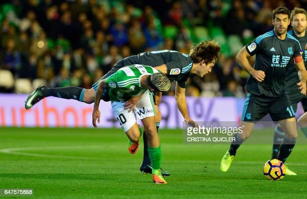 Betis' forward Dani Ceballos vies with Real Sociedad's forward Jon Bautista during the Spanish league football match Real Betis vs Real Sociedad at...