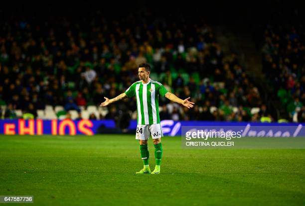 Betis' forward Ruben Castro gestures on the pitch during the Spanish league football match Real Betis vs Real Sociedad at the Benito Villamarin...