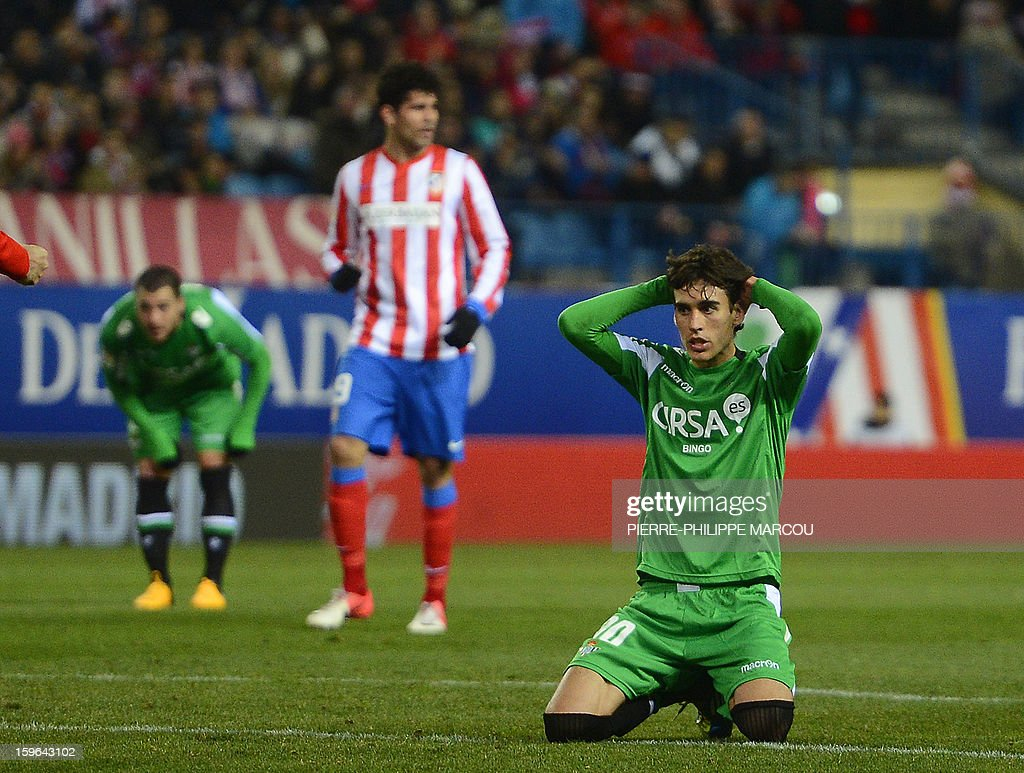 Betis' midfielder Benat Etxebarria (R) reacts during the Spanish Copa del Rey (King's Cup) quarter-final first leg football match Club Atletico de Madrid vs Real Betis at the Vicente Calderon stadium in Madrid on January 17, 2013. AFP PHOTO/ PIERRE-PHILIPPE MARCOU