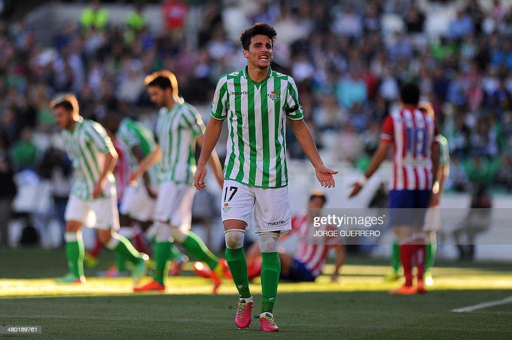 Betis' midfielder Juan Carlos reacts during the Spanish league football match Real Betis Balompie vs Atletico de Madrid at Benito Villamarin stadium...