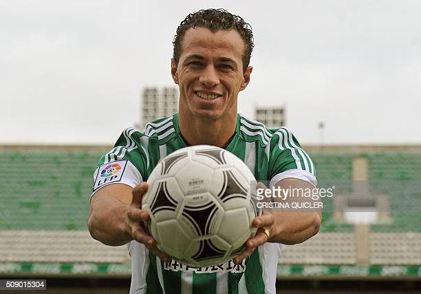 Betis' new signing Brazilian Leandro Damiao poses with a ball during his official presentation at the Benito Villamarin stadium in Sevilla on...