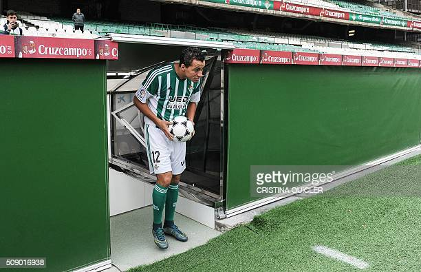 Betis' new signing player Brazilian Leandro Damiao arrives onto the field for his official presentation at the Benito Villamarin stadium in Sevilla...