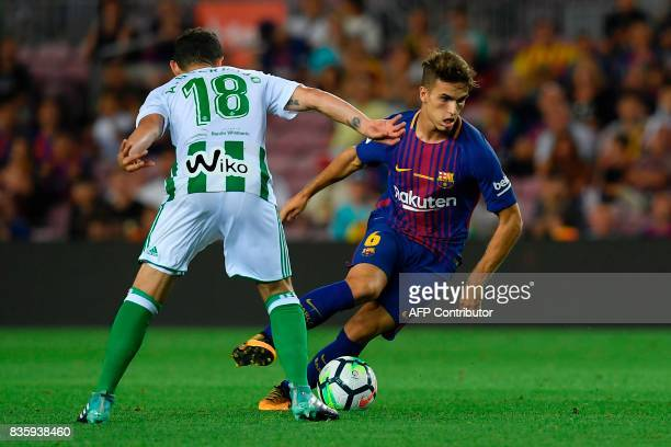 Betis' Ukrainian forward Roman Zozulya vies with Barcelona's midfielder Denis Suarez during the Spanish league footbal match FC Barcelona vs Real...