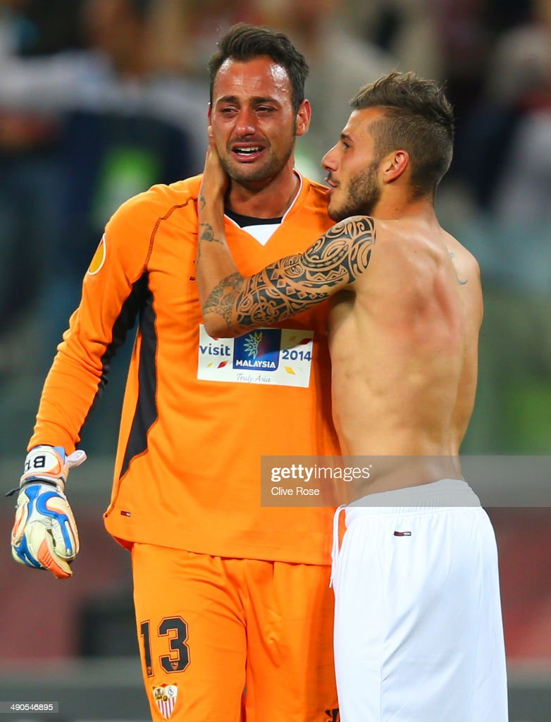 Beto of Sevilla celebrates victory with Diogo Figueiras of Sevilla during the UEFA Europa League Final match between Sevilla FC and SL Benfica at Juventus Stadium on May 14, 2014 in Turin, Italy.