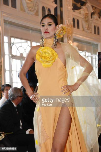 Betsabe Lopez dressed bt Enoka Fonseka walks the runway during 'Fashion Night Couture 2017' Show at Salon des Miroirs on April 26 2017 in Paris France