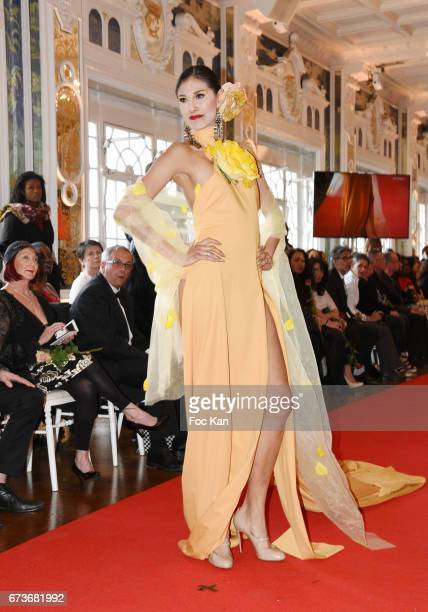Betsabe Lopez dressed by Enoka Fonseka walks the runway during 'Fashion Night Couture 2017' Show at Salon des Miroirs on April 26 2017 in Paris France