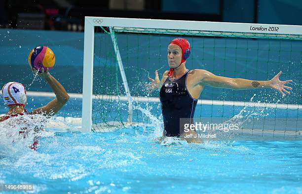 Betsey Armstrong of the USA blocks Roser Tarrago Aymerich of Spain on Day 5 of the London 2012 Olympics at Water Polo Arena on August 1 2012 in...