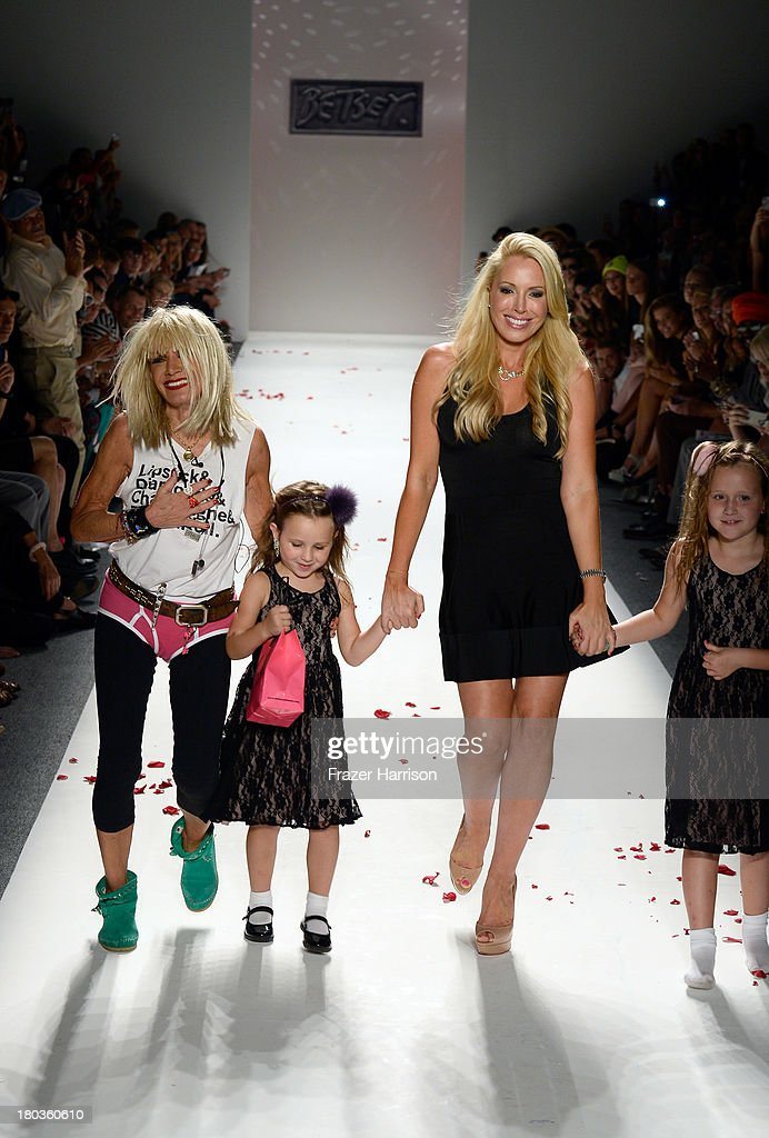 Betsey Johnson and <a gi-track='captionPersonalityLinkClicked' href=/galleries/search?phrase=Lulu+Johnson&family=editorial&specificpeople=852259 ng-click='$event.stopPropagation()'>Lulu Johnson</a> walk the runway at the Betsey Johnson fashion show during Mercedes-Benz Fashion Week Spring 2014 at The Studio at Lincoln Center on September 11, 2013 in New York City.