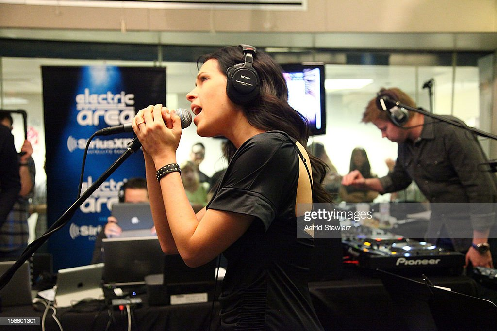 Betsie Larkin and Ferry Corsten perform live for Electric Area's 'Electric Aquarium' series in the SiriusXM Studios December 29, 2012 in New York City.
