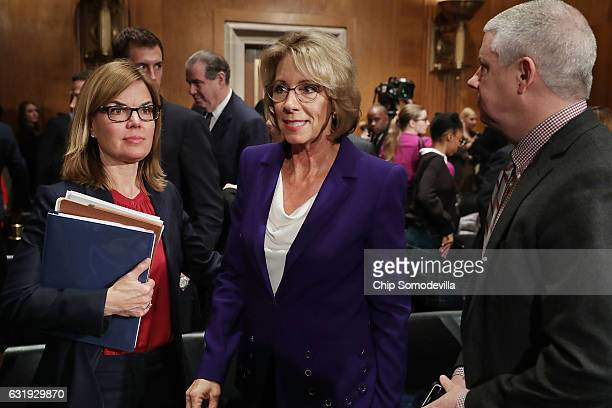 Betsy DeVos Presidentelect Donald Trump's pick to be the next Secretary of Education leaves at the conclusion of her confirmation hearing before the...