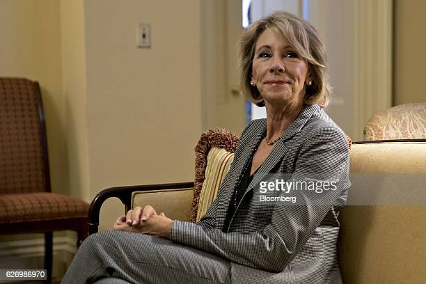 Betsy DeVos secretary of education pick for US Presidentelect Donald Trump sits while meeting with Senate Majority Leader Mitch McConnell a...