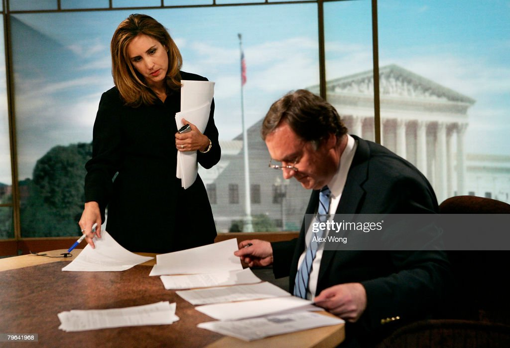 Betsy Fischer Executive Producer of 'Meet the Press' talks to moderator Tim Russert prior to a taping of the show at the NBC Studios April 1 2007 in...