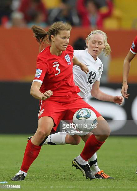 Betsy Hassett of New Zealand battles for the ball with Rachel Unitt of England during the FIFA Women's World Cup Group B match between New Zealand...