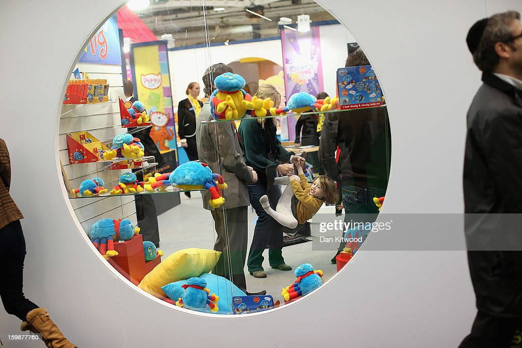 Betsy McCredie, 4, from Glasgow plays inside a trade stand during the 2013 London Toy Fair at Olympia Exhibition Centre on January 22, 2013 in London, England. The annual fair which is organised by the British Toy and Hobby Association, brings together toy manufacturers and retailers from around the world.