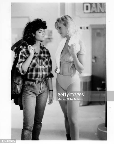 Betsy Russell gets advice on acting and dressing feminine from Kristi Somers in a scene from the movie 'Tomboy' circa 1985
