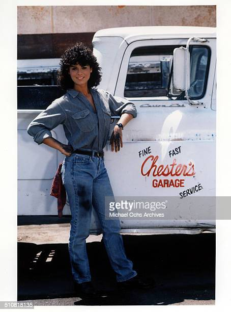 Betsy Russell poses next to a pickup truck for the movie 'Tomboy' circa 1985