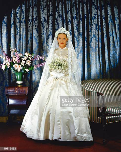 Bette Davis US actress poses in a wedding dress holding a bouquet of flowers in a publicity portrait issued for the film 'The Old Maid' 1939 The 1939...