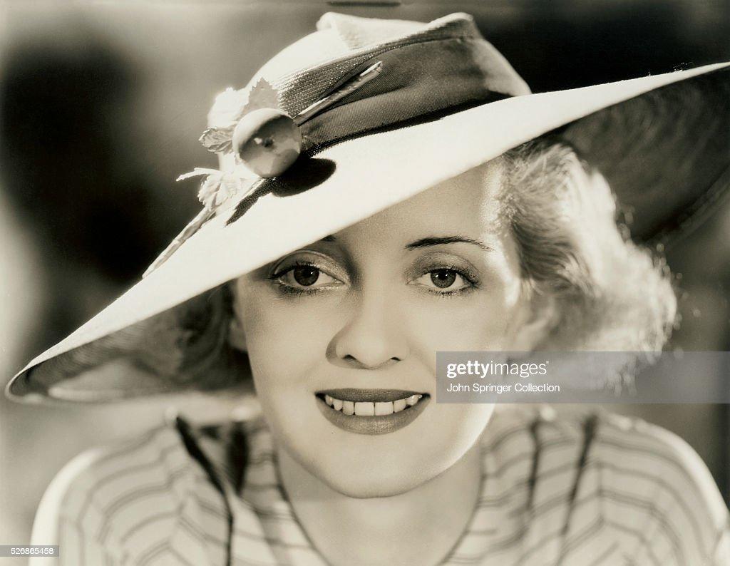 Bette Davis Wearing Wide-Brimmed Hat