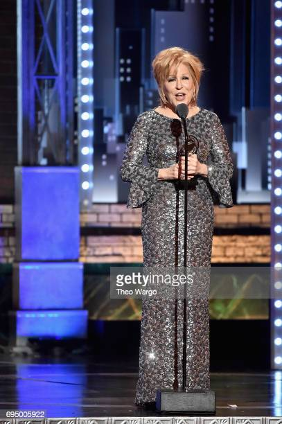 """Bette Midler accepts the award for Best Performance by an Actress in a Leading Role in a Musical for """"Hello Dolly"""" onstage during the 2017 Tony..."""