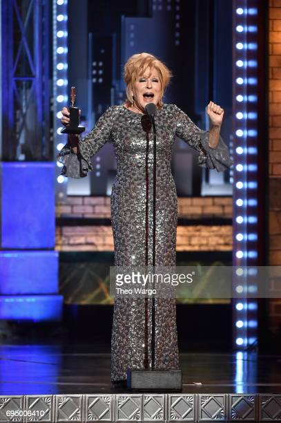 "Bette Midler accepts the award for Best Performance by an Actress in a Leading Role in a Musical for ""Hello Dolly"" onstage during the 2017 Tony..."