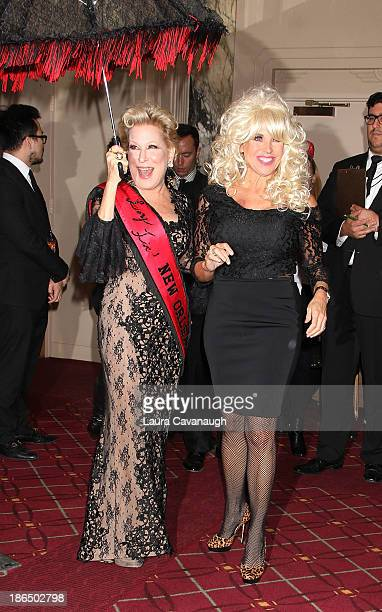 Bette Midler and Katie Couric attend the 18th annual 'Hulaween In The Big Easy' Event at The Waldorf=Astoria on October 31 2013 in New York City