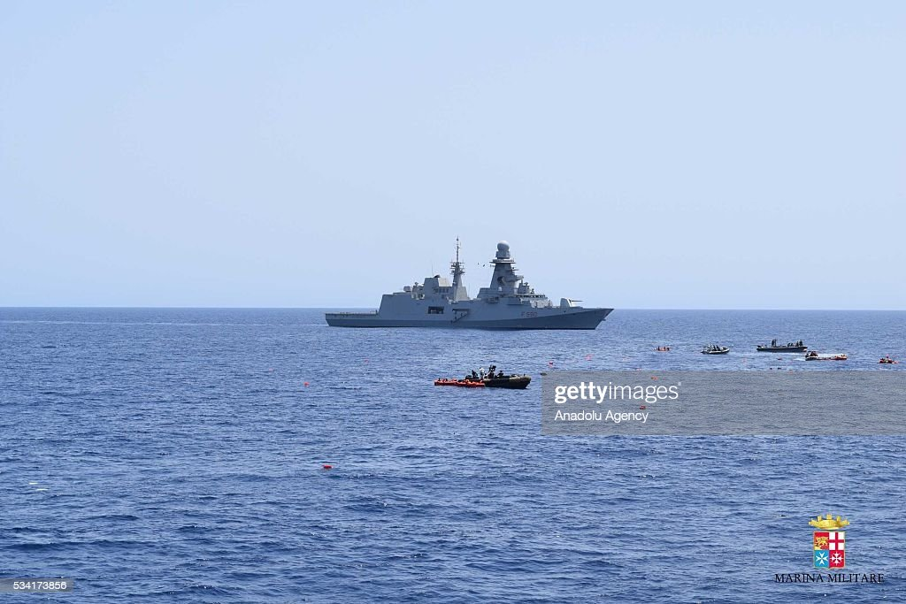 Bettica and Bergamini ships of Italian Navy rescue migrants from an overcrowded boat which was about to capsize at Sicilian Strait, between Libya and Italy, in Mediterranean sea on May 25, 2016. The Italian Navy saved around 500 migrants as they found dead bodies of seven migrants in the sea during the operations.
