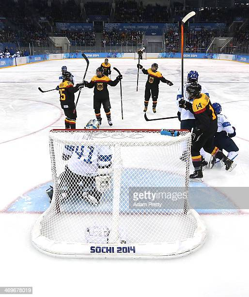 Bettina Evers of Germany celebrates with teammates after scoring against Noora Raty of Finland in the second period during the Women's Ice Hockey...