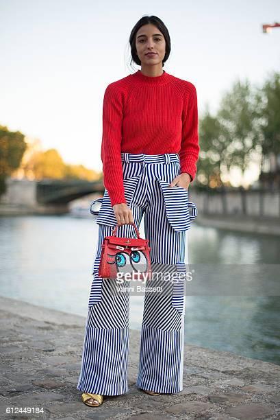 Bettina Looney poses wearing an H and M jumper Richard Malone pants Play No More bag and Gucci shoes before the Paul and Joe show at Les Nautes...
