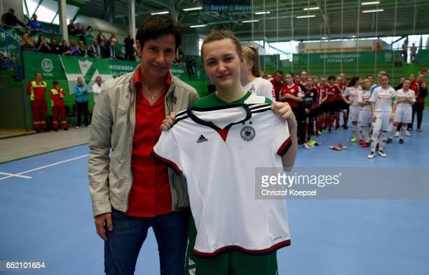 Bettina Wiegmann U15 Women's national coach of Germany honours leading goalscorer Josephine Nowark l00 during the C Junior Girl's German Futsal...