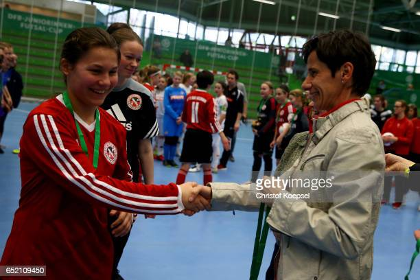 Bettina Wiegmann U15 Women's national coach of Germany honours the second place team of SC Bad Neuenahr after the C Junior Girl's German Futsal...
