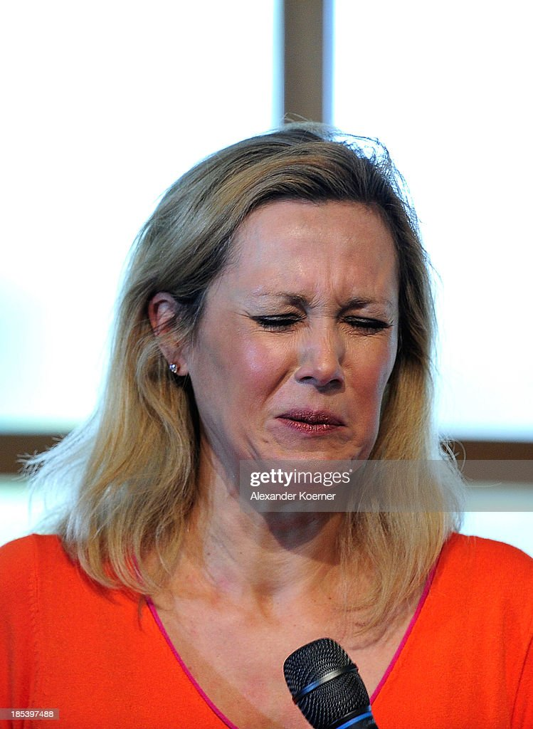 Bettina Wulff reacts to a joke told by Priest Heino Masemann during a church service at the Expowal on October 20, 2013 in Hanover, Germany. - bettina-wulff-reacts-to-a-joke-told-by-priest-heino-masemann-during-a-picture-id185397488